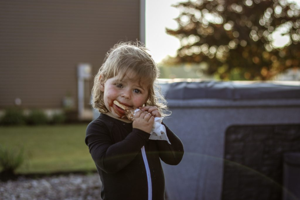 toddler with fudge bar